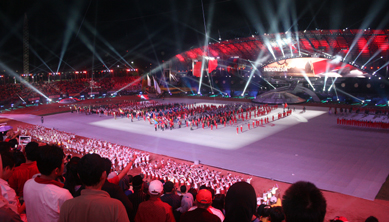 The athletes from host country Indonesia marching in front of honor podium during SEA Games 2011 opening ceremony, Friday, 11-11-2011. Gelora Sriwijaya Stadium, Palembang, Indonesia.